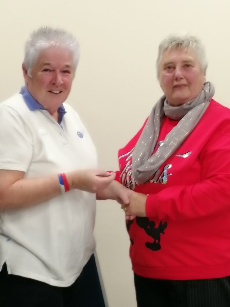 Diane Farrer being presented the Good Service Award by Jean Foulds.