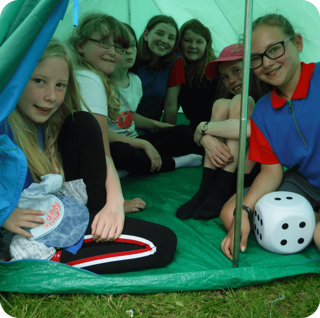 Guides in an old fashioned tent