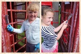 Jenny and Lizzie painting the Phone box.